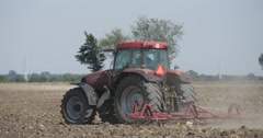Tractor is Plowing The Field Tracing Left Plowing the Field long the Road - stock footage