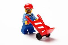 Toy man whit hand truck Kuvituskuvat