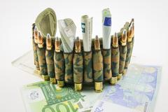 composition with bullets and euros - stock photo
