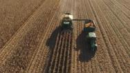 Stock Video Footage of aerial view of a maize harvester filling a tractor trailer