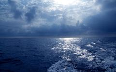 blue sea in stormy dramatic sky day - stock photo