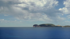 Sunrays through Rain cloud over Capo Caccia Sardinia Italy - 25FPS PAL Stock Footage