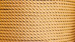 Brown rope in big round reel Stock Photos