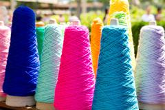 Embroidery colorful thread spools Stock Photos