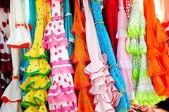 Colorful gipsy dresses in rack hanged in Spain Kuvituskuvat