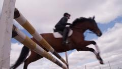Horse Jumping over the bar in slow motion Stock Footage