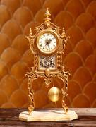 ancient vintage golden brass pendulum clock - stock photo