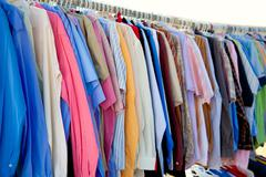 Fashion shirt rack with colorful clothes Stock Photos