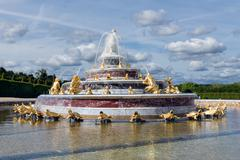 Ornamental pond with fountains in garden Palace Versailles Paris Stock Photos