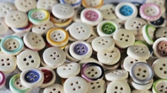 Mixed coloured buttons background - stock footage