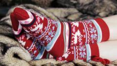 Female legs in Christmas socks under a blanket of fur Stock Footage