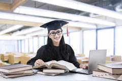 Young bachelor studying in library Stock Photos