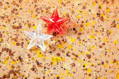 christmas prism stars on recycled pape - stock photo