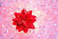 Christmas gift ribbon on red ice Stock Photos
