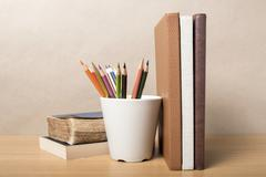 book and color pencil - stock photo