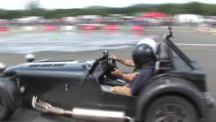 Caterham car doing donuts Stock Footage