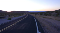 Evening shot of a long and empty road in Arizona. Stock Footage
