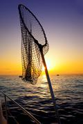 Dip net in boat fishing on sunrise saltwater Stock Photos