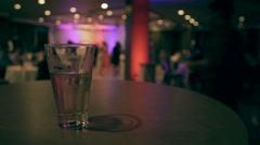 Beer Glass in Foreground of Dance Floor Stock Footage