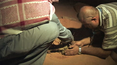 Stock Video Footage of Bedouins Start Fire in Pastoral Settings in the Wadi Rum, Jordan