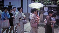 Okayama, JAPAN 1972: Women walking to a function in traditional Japanese kimono Stock Footage