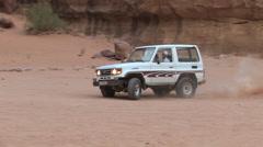 Stock Video Footage of Jeep Off-Roading through Pastoral Settings in the Wadi Rum, Jordan