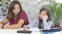 a teen helping his sister with homework - stock footage