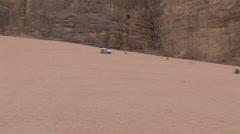 Jeep Off-Roading through Pastoral Settings in the Wadi Rum, Jordan - stock footage