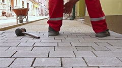 Masons hands are fitting flagstone. - stock footage