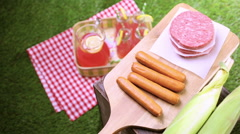 Summer picnic with small charcoal grill in the park. Stock Footage