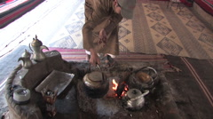 An Arab Man cooks in a traditional way in the WADI RUM, JORDAN Stock Footage