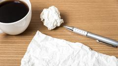 Paper and crumpled with pen and coffee cup Stock Photos
