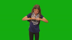 Young girl in front of chroma key - sharpening pencil - stock footage