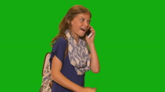 Young girl in front of chroma key - making a call on cell phone - stock footage