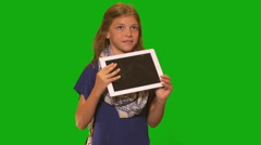 Young girl in front of chroma key - Holding Tablet Computer - stock footage