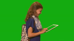 Young girl in front of chroma key - Side profile of tablet computer - stock footage