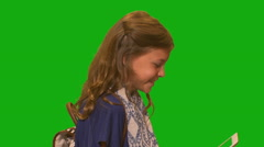 Young girl in front of chroma key - Side profile holding tablet computer Stock Footage