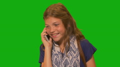 Young girl in front of chroma key - talking on cell phone Stock Footage