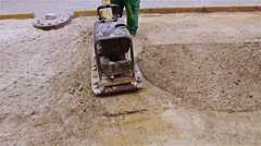 Soil compacting is at construction site in the city street. Stock Footage