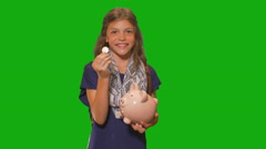 Young girl in front of chroma key - coin and piggy bank Stock Footage