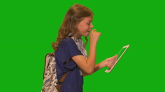 Young girl in front of chroma key - laughing with tablet computer - stock footage