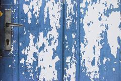 Blue Door With Peeling Paint Stock Photos
