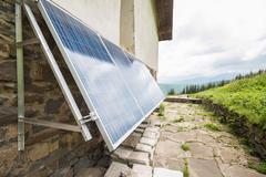 Solar panels on apline hut - stock photo
