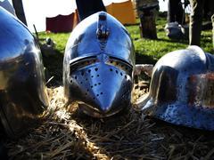 Medieval metal helmets. - stock photo