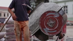 Making concrete in old mixer. Stock Footage