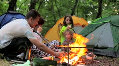 Bonfire night in a tent camp in the countryside - stock footage