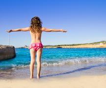 Girl beach rear view in San Antonio of Ibiza Kuvituskuvat