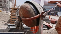 Discharge concrete mixer - stock footage