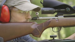 Loading a Shot Gun and Firing at a Range Stock Footage