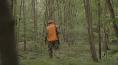 Gun hunter walking through the woods Stock Footage